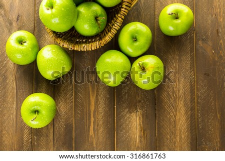 Organic Granny Smith apples on the table. - stock photo
