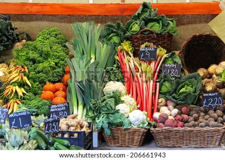 Organic green vegetables at farmers market - stock photo