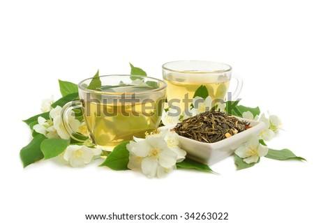 Organic jasmine tea leaves with fresh jasmine flowers and cups of tea on white background - stock photo