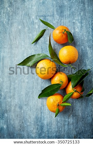Organic mandarin oranges with leaves - stock photo