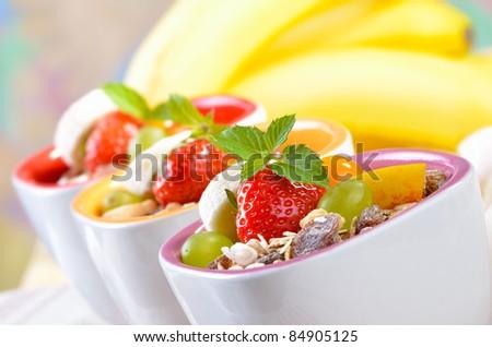 Organic muesli with fresh fruit - stock photo
