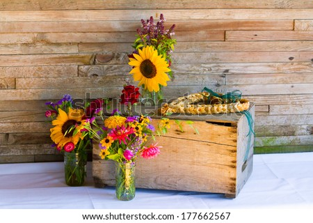 Organic natural wildflowers are placed in mason jars to create the wedding decor for this Oregon reception. - stock photo