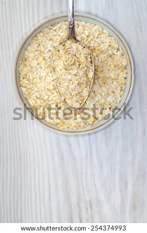 Organic Oatmeal in a Ceramic Bowl. Top view. - stock photo