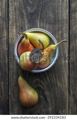 Organic pears on dark wooden table. From above - stock photo