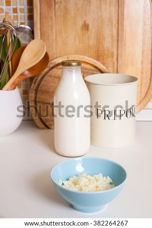 Organic probiotic milk kefir grains inside the bowl. The word Pripomocki in the iron bowls in english is flatware container - stock photo