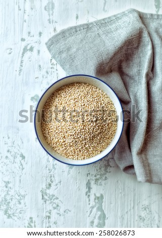 Organic quinoa in a bowl  - stock photo