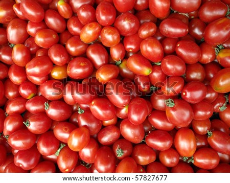 Organic red Grape Tomatoes background on display at a farmers market in San Francisco - stock photo