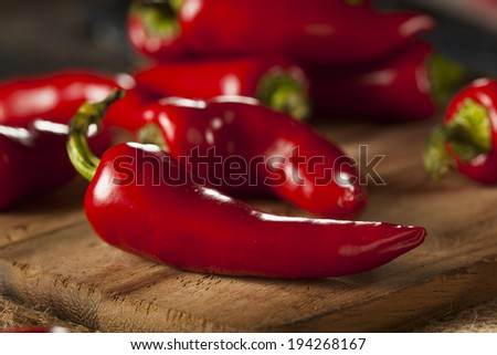Organic Red Spicy Fresno Peppers on a Background - stock photo
