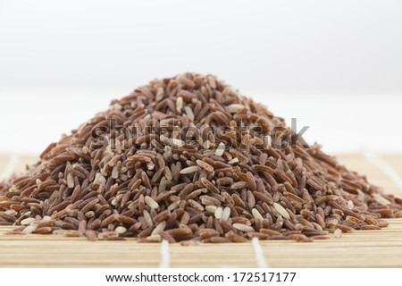 Organic rice as baboo wooden background - stock photo