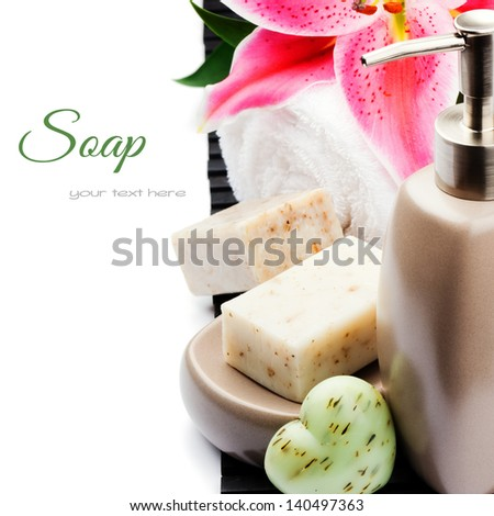 Organic soap, towel and lily isolated over white - stock photo