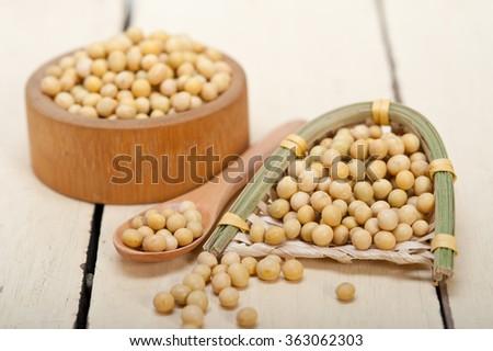 organic soya beans over rustic wood table macro closeup - stock photo