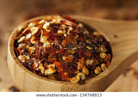 Organic Spicy Red Pepper Flakes used for cooking - stock photo