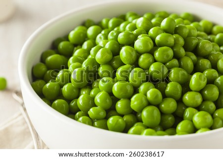 Organic Steamed Fresh Green Peas in a Bowl - stock photo