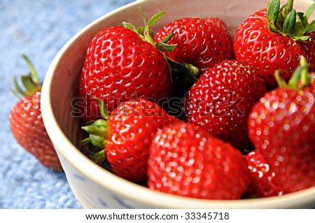 Organic strawberries in rustic bowl - stock photo