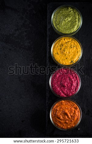 organic vegetable dip selection, food border background - stock photo
