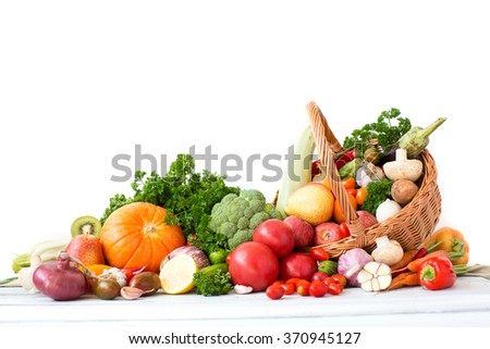 Organic vegetables and fruits in wicker basket isolated. - stock photo