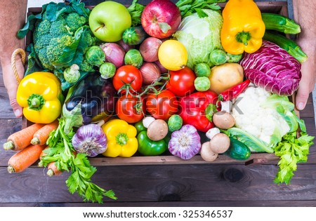 Organic vegetables in wood box. - stock photo