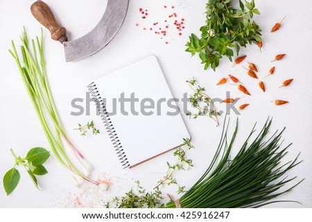 Organic vegetarian ingredients, olive oil and seasoning on rustic wooden cutting board over dark vintage background with space for text.Healthy food, or diet nutrition concept.selective focus. - stock photo
