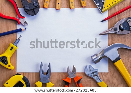 organized copyspace horizontal version white blank sheet of paper and tools on wooden board  - stock photo