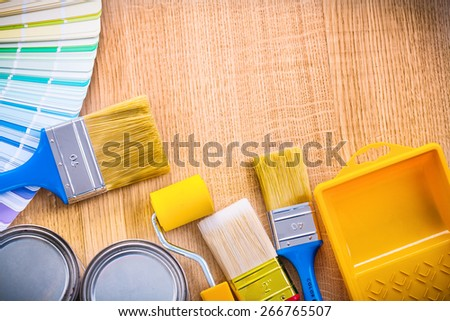 organized copyspace image paint brush roller can tray color palette  - stock photo