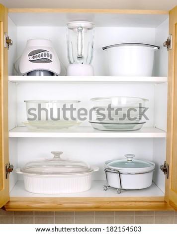 Organized kitchen cupboard - stock photo
