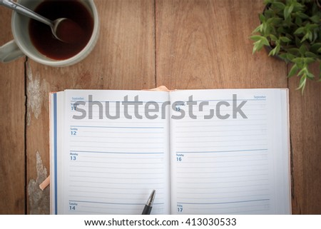 Organizer and Pen on wooden table background -Business planning. - stock photo
