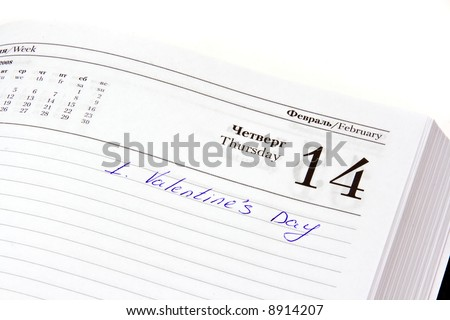 Organizer open on the Valentine's day date with mark written by hand - stock photo