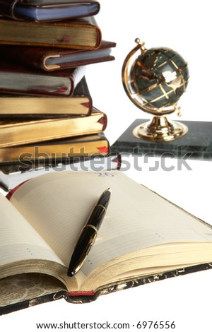 Organizer, pen, books and a globe on a white background - stock photo