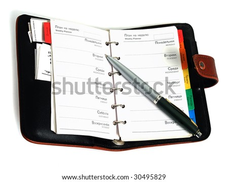 Organizer - weekly planner with pen - stock photo