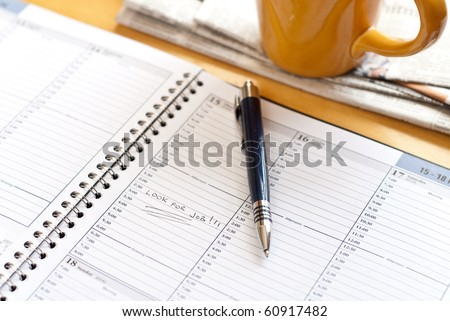 Organizer with Reminder to Search for Job - stock photo