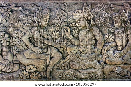 Oriental background. Man and woman surrounded by floral ornament. From a balinese temple - stock photo