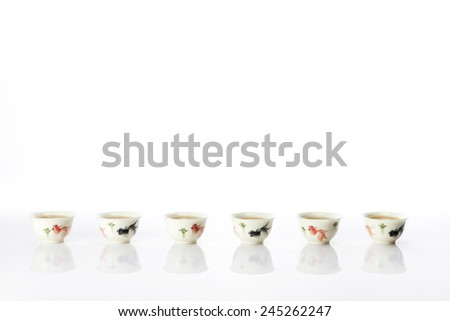 Oriental (chinese) tea cups isolated white at the studio. - stock photo