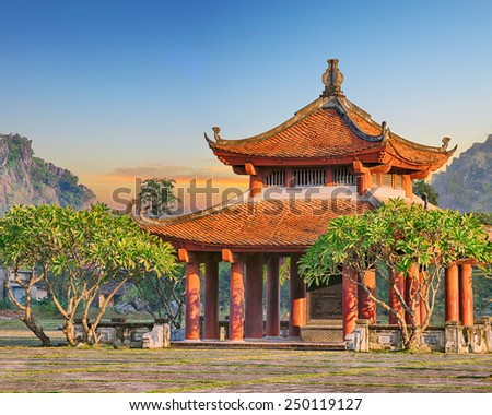 Oriental chinese traditional red temple during sunrise - stock photo