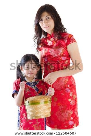 Oriental family in chinese red cheongsam dress, celebrating Chinese new year, isolated on white background - stock photo