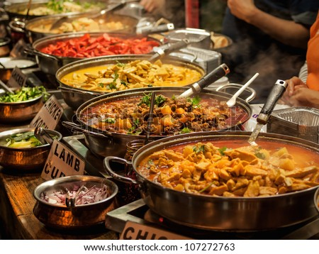 Oriental food - Indian takeaway at a London's market - stock photo