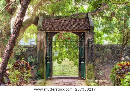 oriental gate in the tropical asian garden, Ninh Binh province, Vietnam - stock photo
