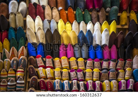 Oriental Moroccan slippers on display in the medina of Fez - stock photo
