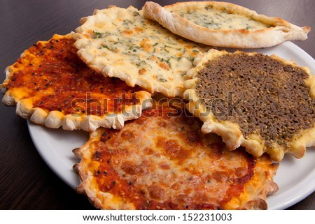 Oriental pizza plate of traditional Arabic food manaqish. - stock photo