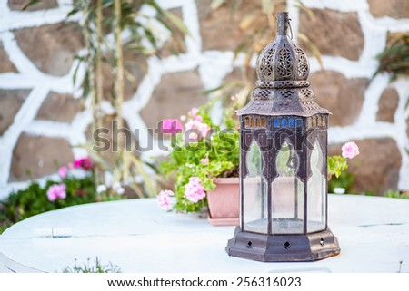 Oriental style lantern on a table - stock photo
