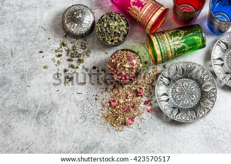 Oriental tea table setting. Dishes and glasses. Holidays food background - stock photo