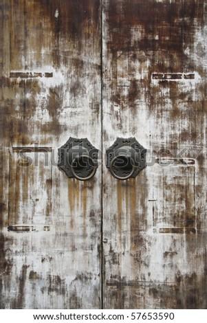 oriental traditional wood door and knocker - stock photo