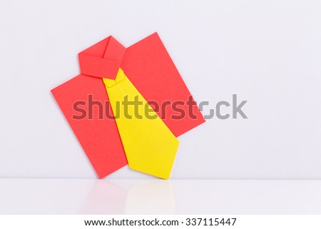 origami a man's shirt on a white background. - stock photo