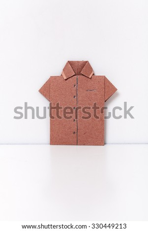 origami a man's shirt on a white background red of paper - stock photo