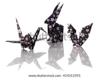Origami animals, crane, squirrel and rabbit isolated on white background. - stock photo