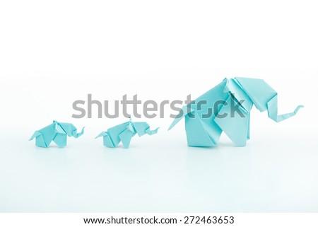 Origami blue elephant family on white background.Mum leading the childs - stock photo