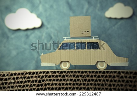 origami car made of cardboard paper  - stock photo