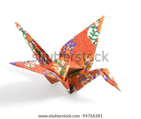 Origami Crane folded with a red floral pattern paper - stock photo