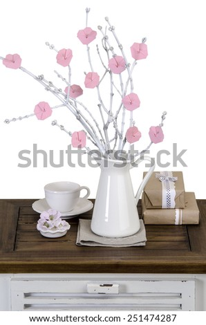 origami flowers on the white branches in a jar on vintage nightstand - stock photo