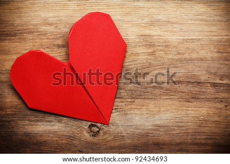 Origami heart on wooden background with copy-space - stock photo