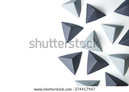 Origami pyramids abstract background with free copy space is great for using in web - stock photo